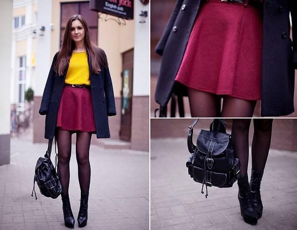 черное пальто и желтый свитер